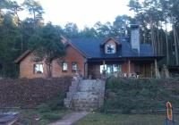 Zděný dům s roubeným obkladem